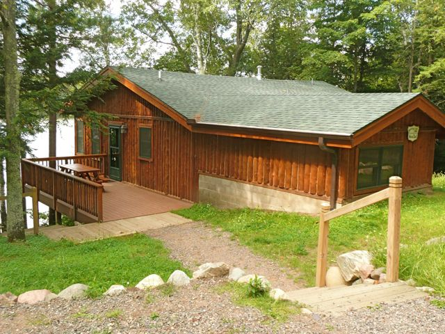 This large vacation home is close to the lakefront, 30 feet, elevated off the lake which provides spectacular long views of the wilderness islands and sunsets. Stairs lead down to a lovely lake-edge hiking trail and a shared dock. There is a brand new deck, perfect for lounging while overlooking the lake. Grill and picnic area have there own spot off the deck and an outdoor fire ring is shared with the cabin next door, Whistle Wings. Recently completely remodeled, Wood Duck and its views take your breath away.