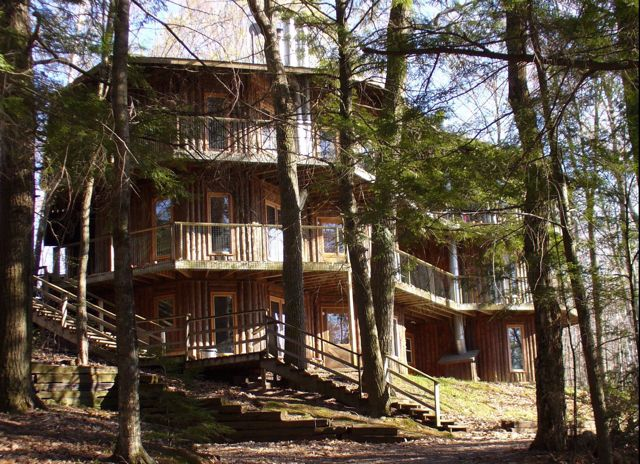 Woods Hill oversees the beauty of Teal Lake sunsets and feels very lakeside with a gorgeous wrap around deck. This warm and airy one- level home sits on a hill sloping down to the lake shore only 75 feet away. Woods Hill shared dock is just down a series of steps from the cabin.